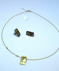 Handmade 925 Silver Necklace  with goldplated details and matching earrings.